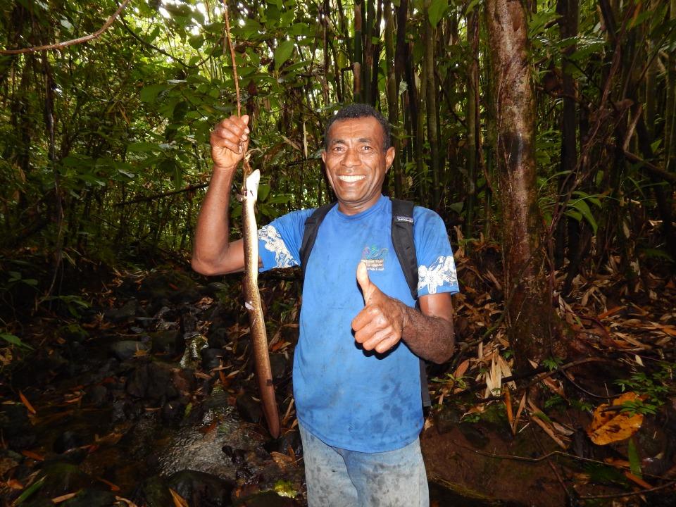 Ranuka and his freshly caught duna (freshwater eel).